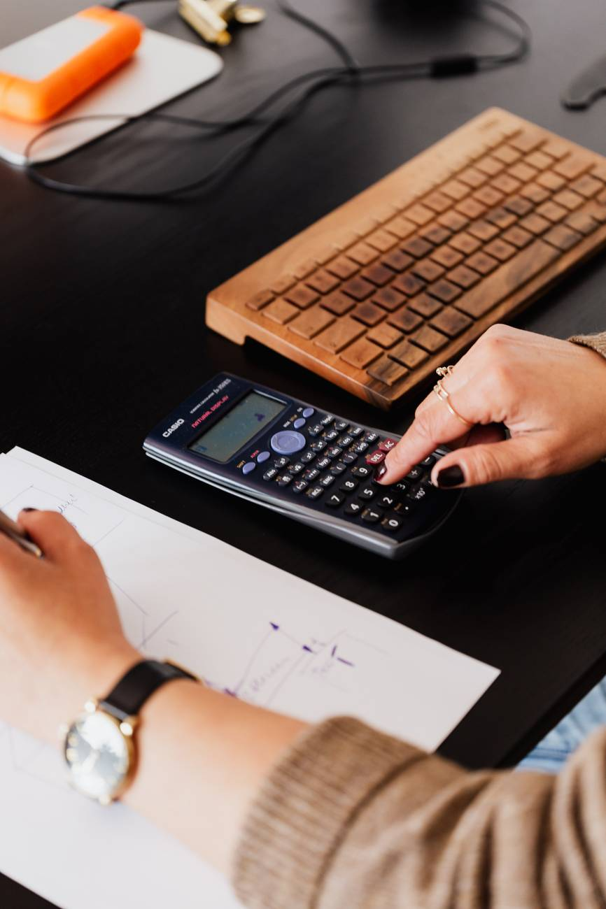 crop bookkeeper using calculator and taking notes